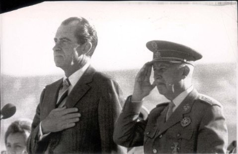 PKT3423B - 254152 PRESIDENT RICHARD NIXON MADRID AIRPORT- US President Nixon, left, and Spanish Chief of State Gen Francisco Franco salute as the US and Spanish national anthems are played at Madrid airport today before Pres Nixon's plane took off for London at the end of his one-day stay here.