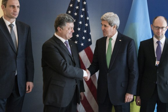 """Ukrainian businessman and politician Petro Poroshenko (2nd L) and US Secretary of State John Kerry (2nd R) shake hands as the head of the Ukrainian UDAR (Punch) party Vitali Klitschko (L) and Ukrainian opposition leader Arseniy Yatsenyuk look on prior to a meeting during the Munich Security Conference at the Bayerischer Hof Hotel February 1, 2014 in Munich, southern Germany. The annual meeting of the global """"strategic community"""" was set to deal with thorny international issues, from the Syrian war and Ukraine's turmoil to Iran's nuclear programme and US online surveillance. AFP PHOTO / POOL / BRENDAN SMIALOWSKI (Photo credit should read BRENDAN SMIALOWSKI/AFP/Getty Images)"""